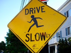 Grammar-check for a road sign, online at Flickr: drive slowly.